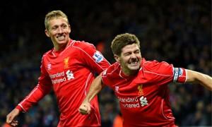 Lucas Leiva watches his Liverpool team-mate Steven Gerrard celebrating after scoring