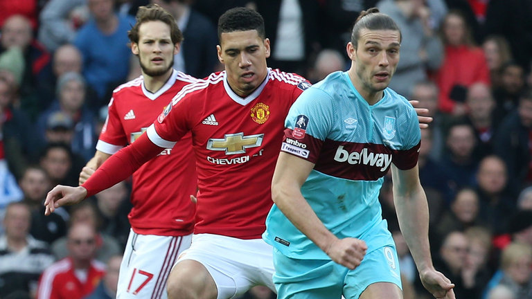 andy-carroll-chris-smalling_3430722