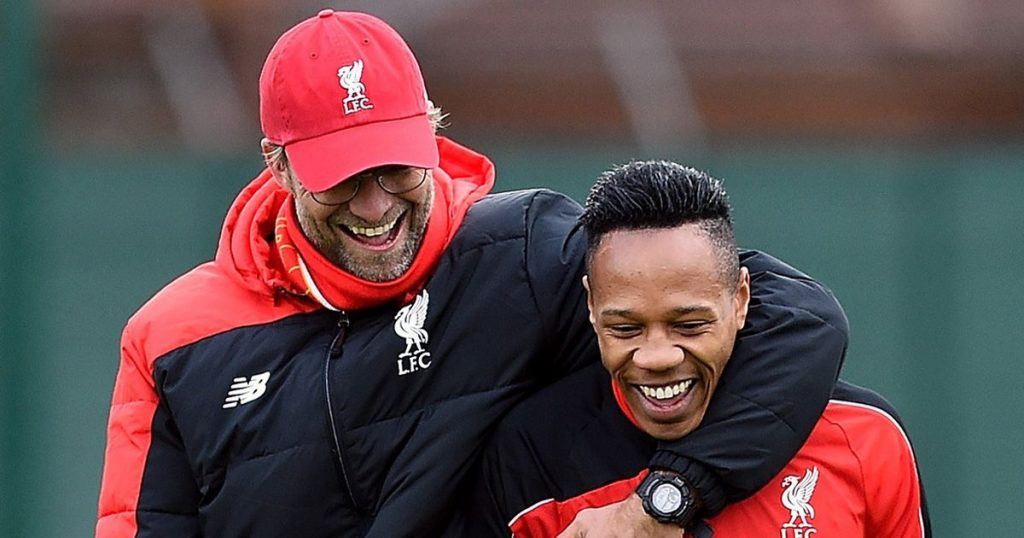 jurgen-klopp-laughs-with-nathaniel-clyne-during-a-training-session