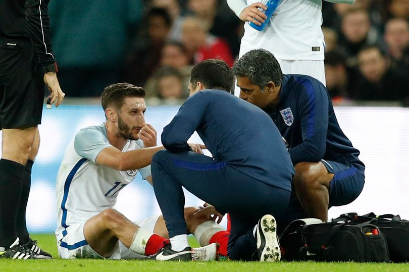 englands-adam-lallana-receives-medical-attention