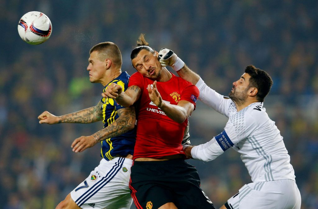 manchester-uniteds-zlatan-ibrahimovic-in-action-with-fenerbahces-volkan-demirel-and-martin-skrtel