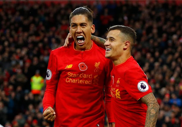 liverpools-roberto-firmino-celebrates-scoring-their-fourth-goal-with-philippe-coutinho